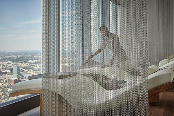 The spa is on the 57th floor and features an infinity pool and treatment rooms overlooking the city