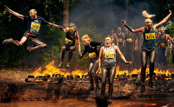 Tough Mudder challenges its participants with fire and electric shocks