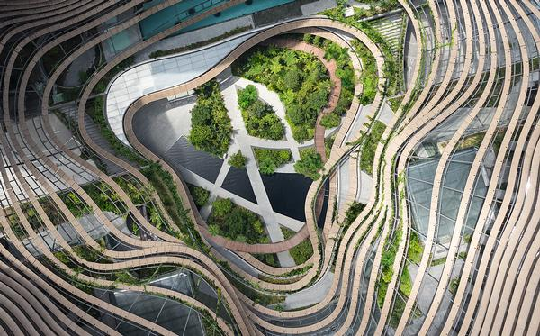 A winding ramp allows visitors and residents to ascend from ground level through rich vegetation
