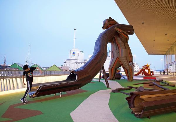 A giant bear watches over Aarhus's harbour. The playground is part of Schmidt Hammer Lassen's Dokk1 library project