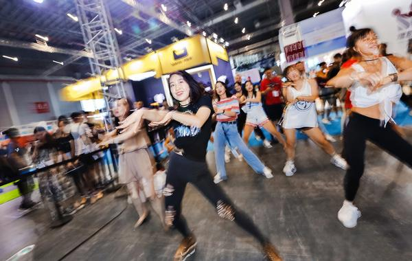 Group exercise classes and bodybuilding demonstrations entertained the crowds at FIBO China