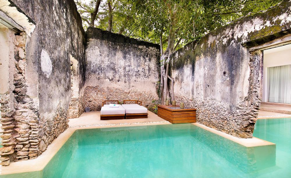The hacienda's original crumbling walls form a key part of the design