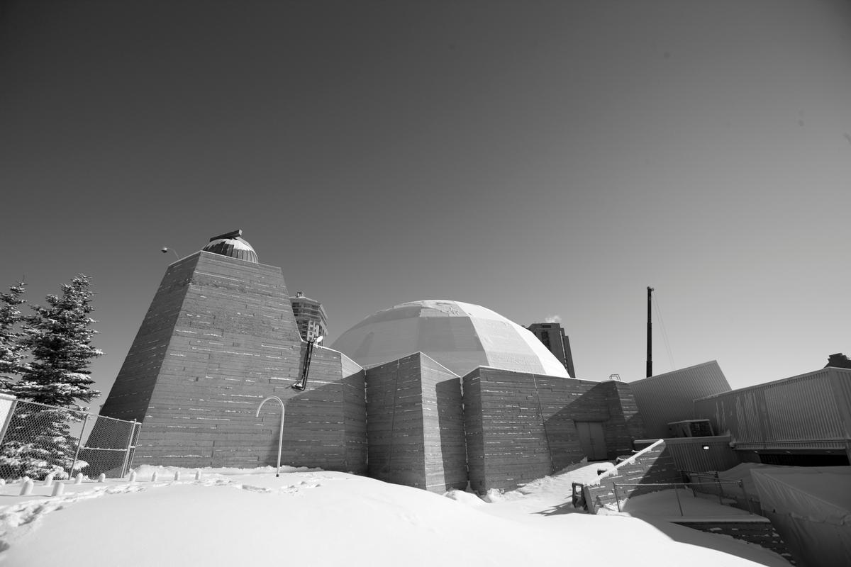 Built in 1967, the Centennial Planetarium is somewhat of an icon in the city of Calgary due in part to its brutalist architecture and the concrete dome that sits atop its main structure / Gerard Yunker
