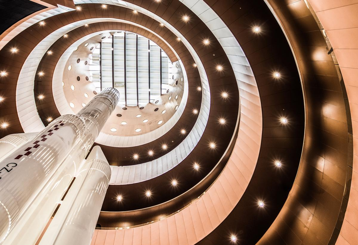 The grand lobby, which is lit by multiple portholes – has been likened to a solar chimney. / Photo by Kris Provoost