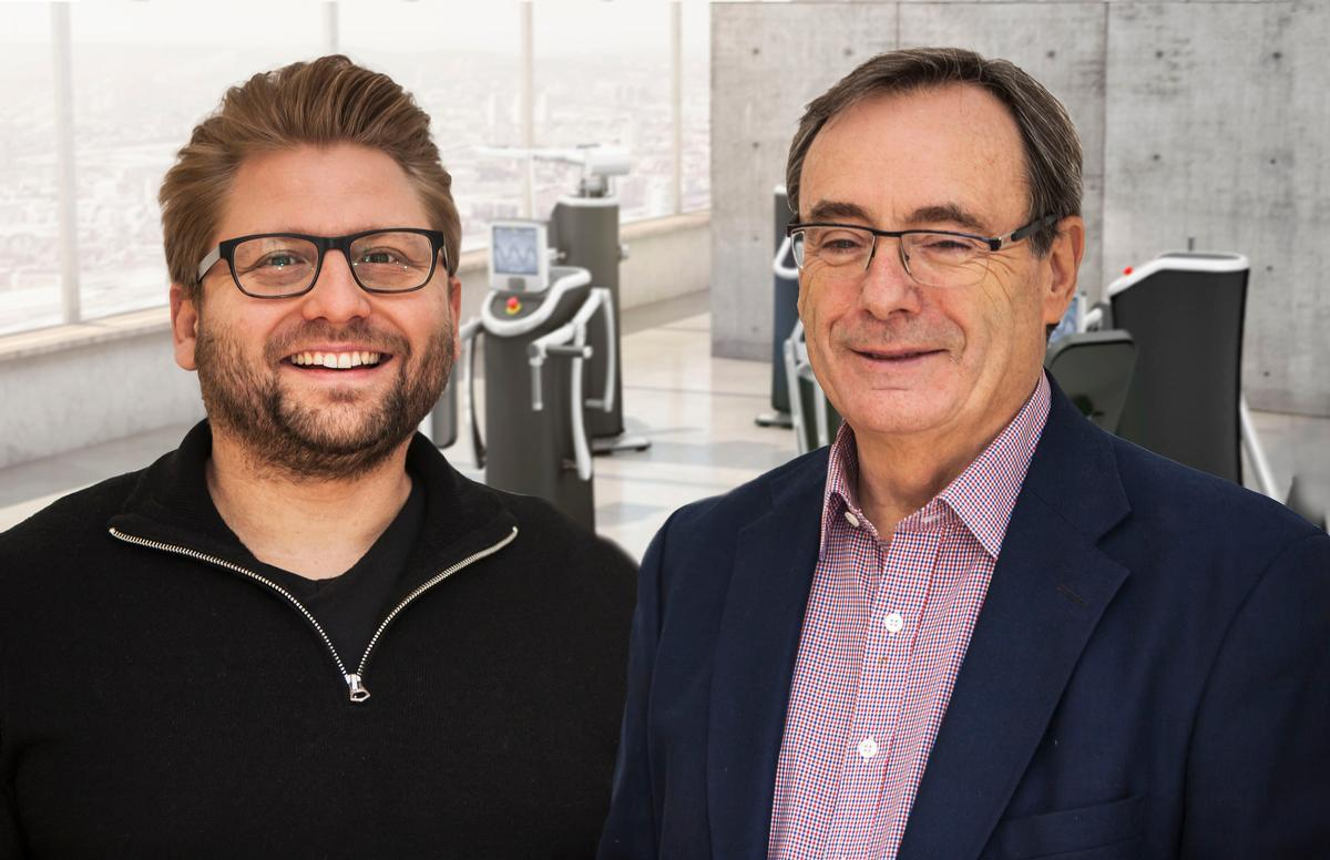 Sir George (right) with eGym co-founder Philipp Roesch Schlanderer (left)