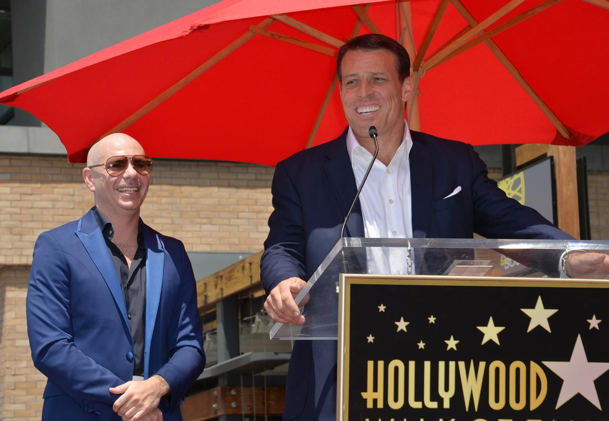Tony Robbins (right) rapper Pitbull (left) will open the first Grit Bxng studio in June