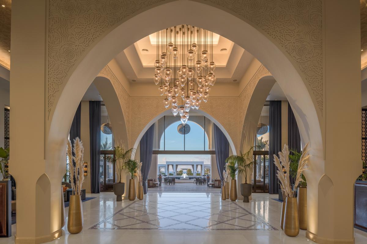 The complex draws on traditional Moroccan and Islamic architecture; horseshow arches and riad-like layouts appear throughout the property. / Courtesy of Hilton Hotels
