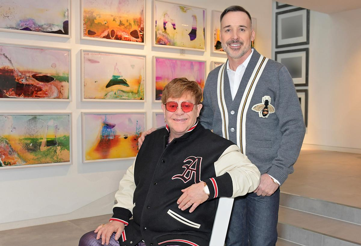 Sir Elton John and David Furnish at home in their art gallery / Dave Benett Getty Images for the V&A