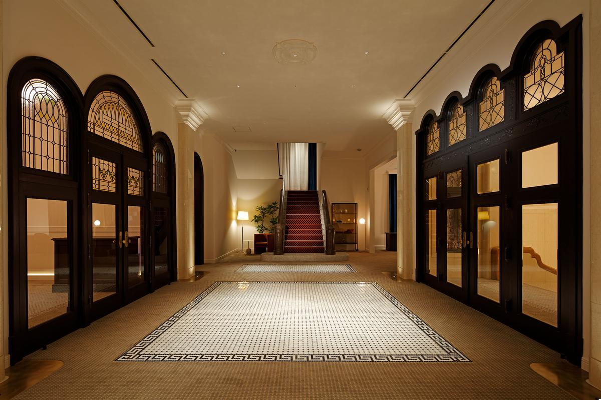 Reception and lounge areas feature mosaic floors and fanlights. / Photo by Kozo Takayama