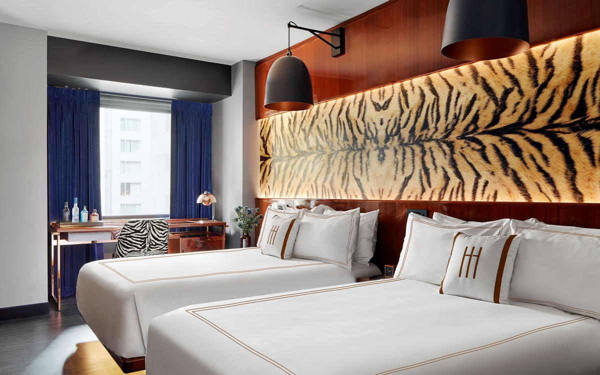 Guestrooms feature a number of faux animal skin furnishings. / Courtesy of Marcello Pozzi