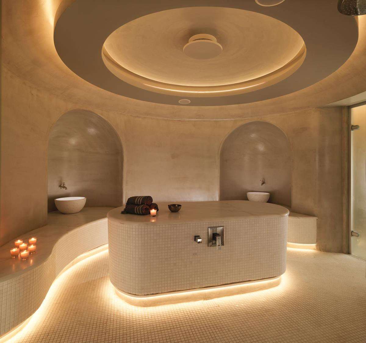 Cavernous spaces inside the resort mirror the interiors of Cycladic houses. / Courtesy of Niall Clutton