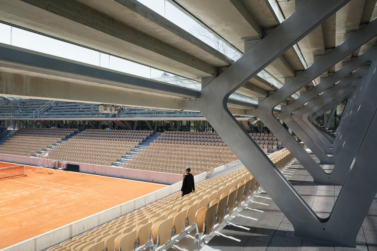 The stadium is situated amidst the 120-year-old Serres d'Auteuil botanical gardens. / Courtesy of Marc Mimram