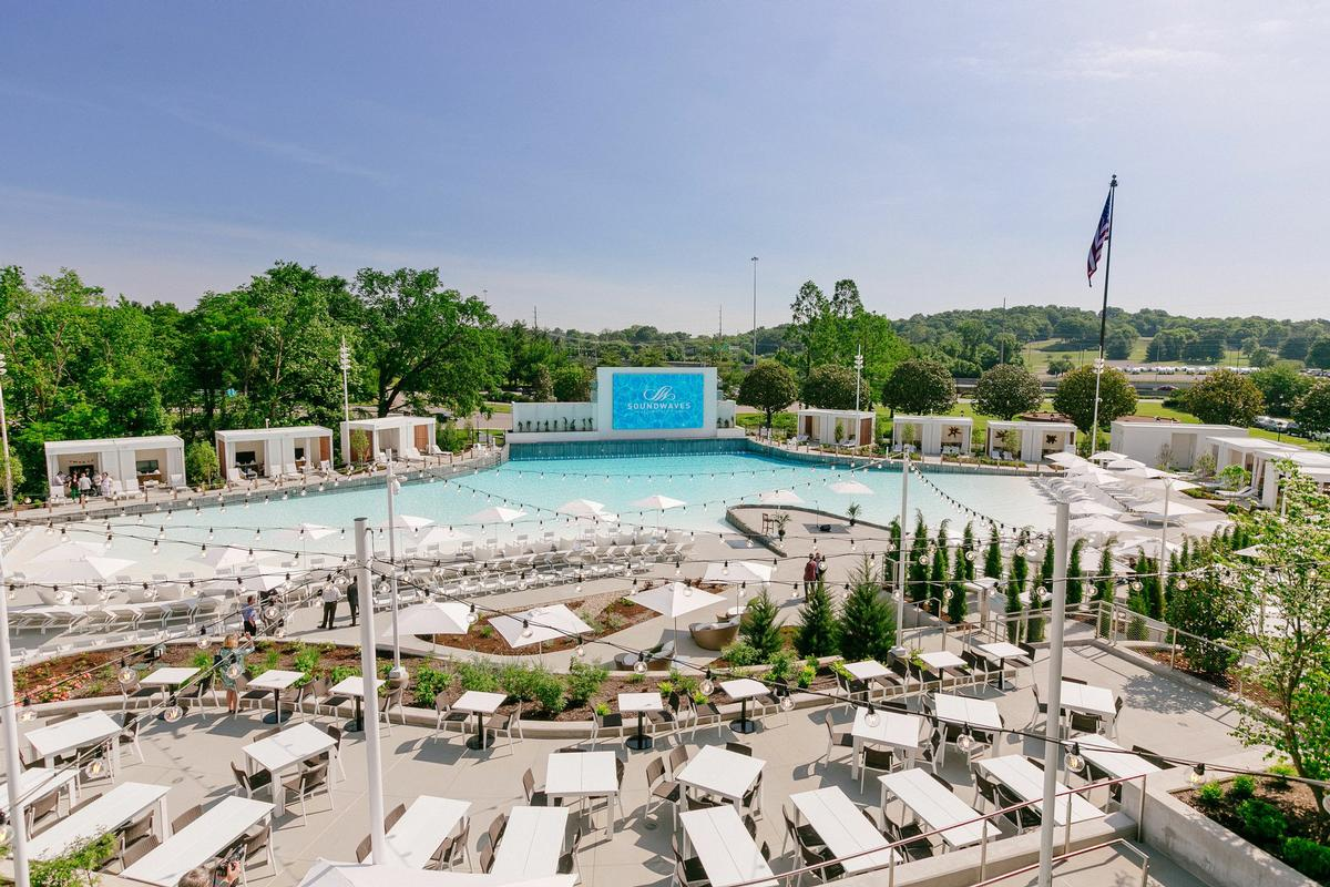 The new outdoor wave pool has a giant poolside LED movie screen