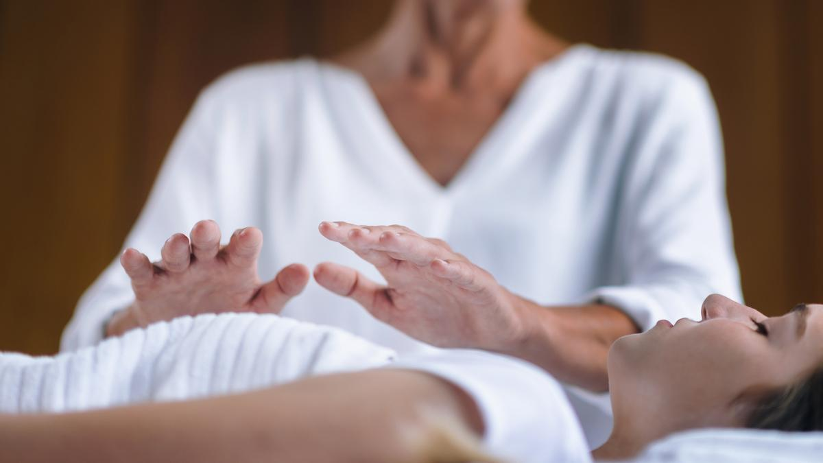 One of the topics in the White Paper is how how energy-based therapies, such as Reiki, can add to the bottom line / Shutterstock