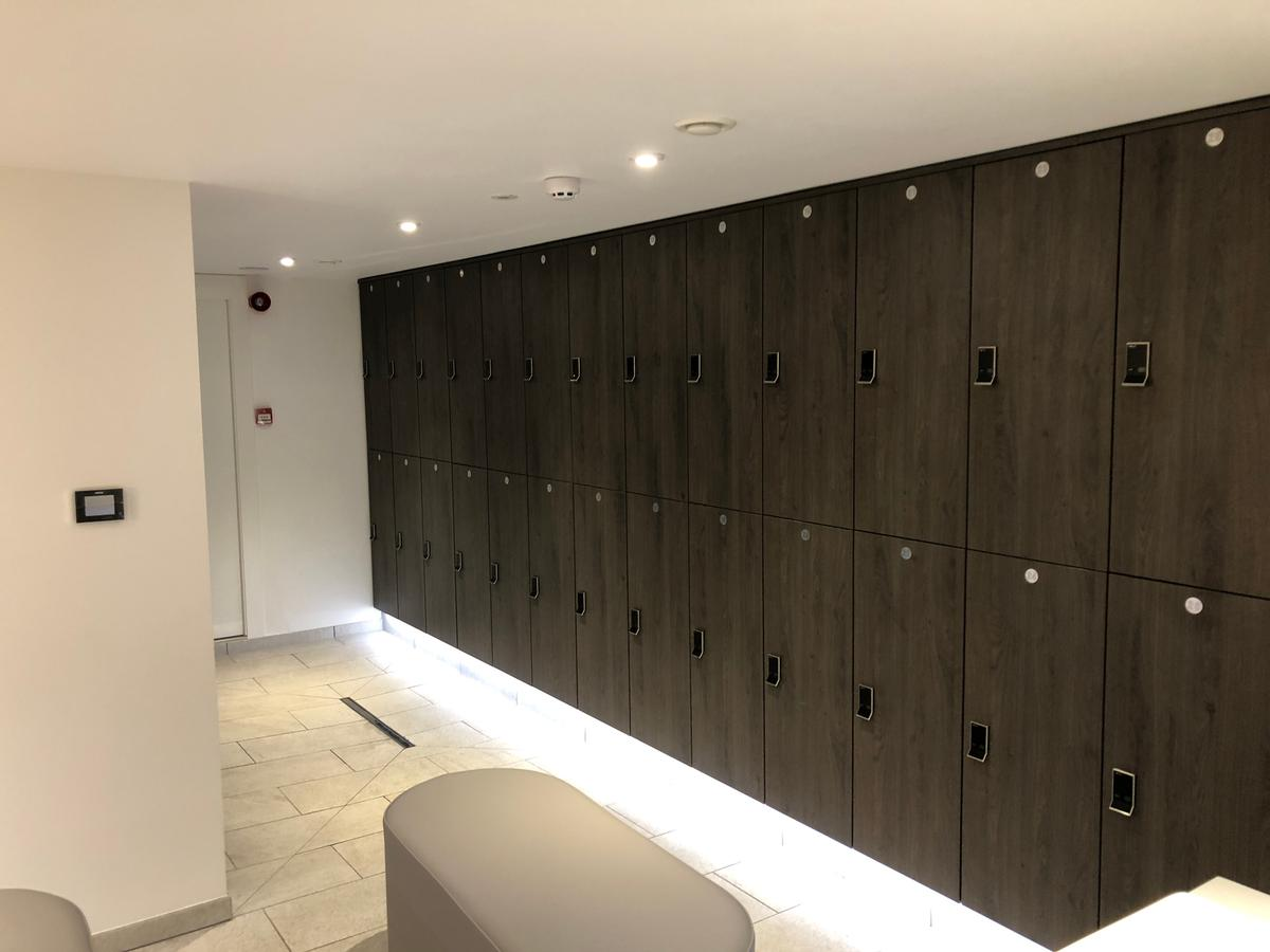 Crown Sports Lockers installed rain of Nebraska Oak clothes lockers with RFID Digilocks in the changing rooms