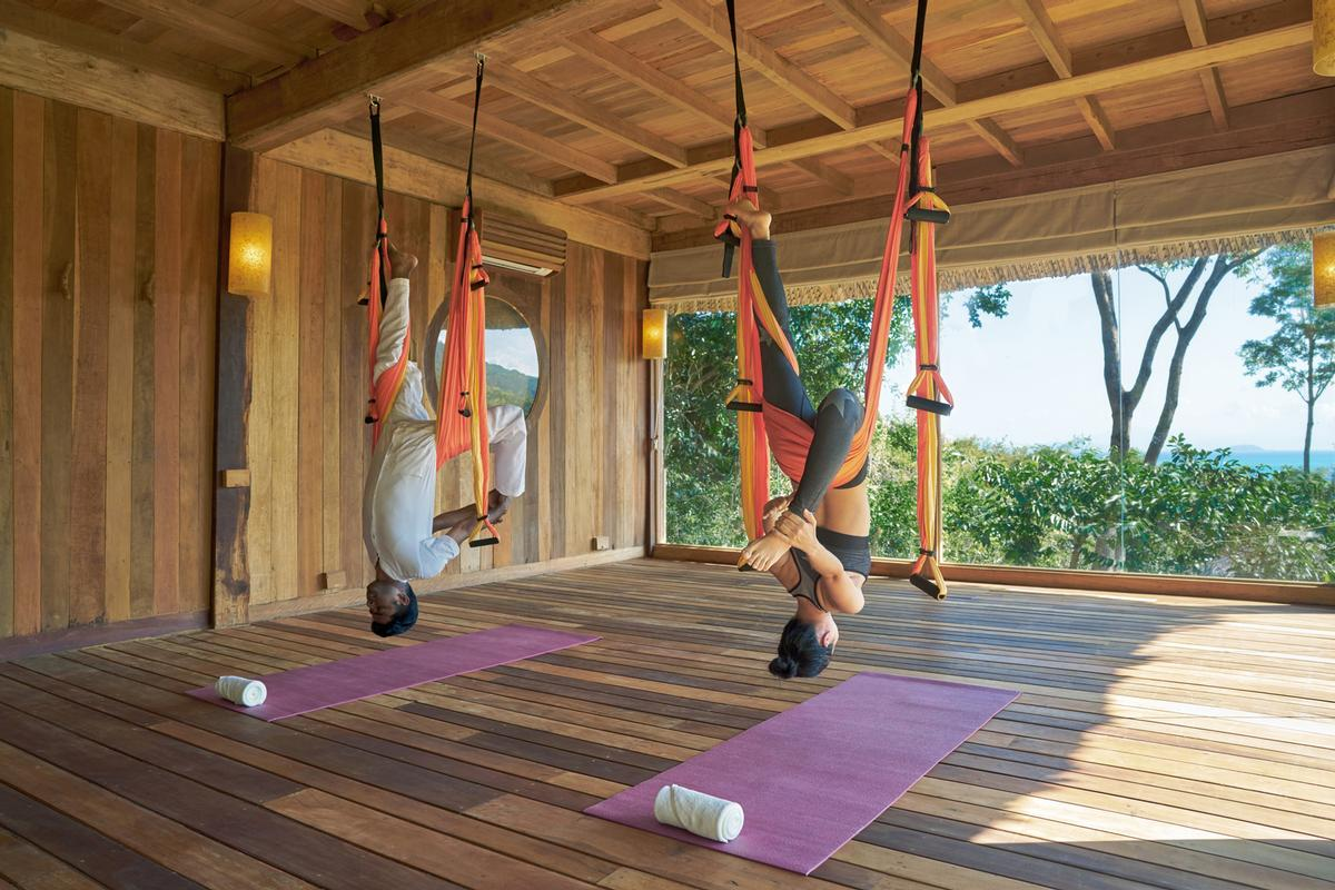 Flying yoga improves flexibility and balance and gives guests the unique sensation of flying
