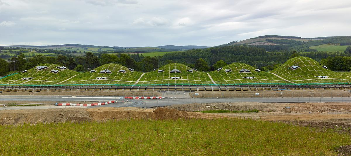 The Macalan: The distillery takes its cues from ancient Scottish earthworks. The undulating roof is planted with a Scottish wildflower meadow and rises and falls over the production cells beneath / Mark Power