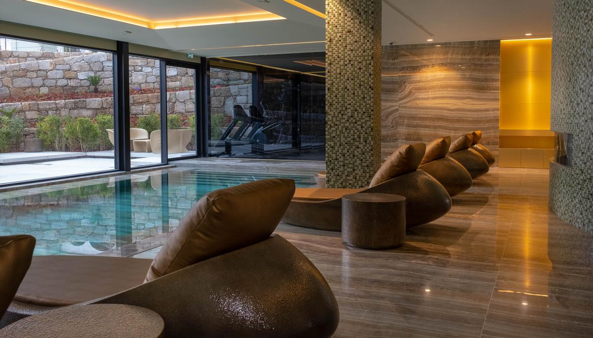 The hotel's spa includes a Turkish bath and sauna, indoor pool, and an outdoor relaxation area surrounded by lush, landscaped gardens