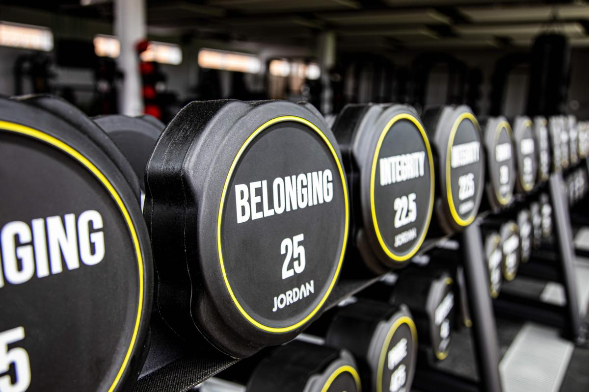 The free weights have been personalised for the club, featuring the club's six core values: Belonging, Commitment, Pride, Resilience, Integrity and Growth