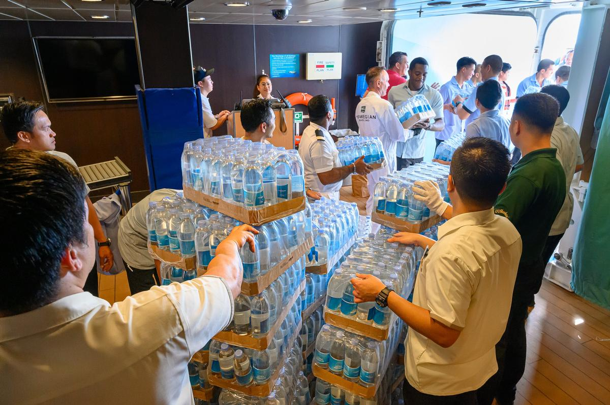 With relief efforts hampered by damage and flooding in the country's airports, the three cruise lines stepped in, sending ships full of supplies to those in need / Norwegian