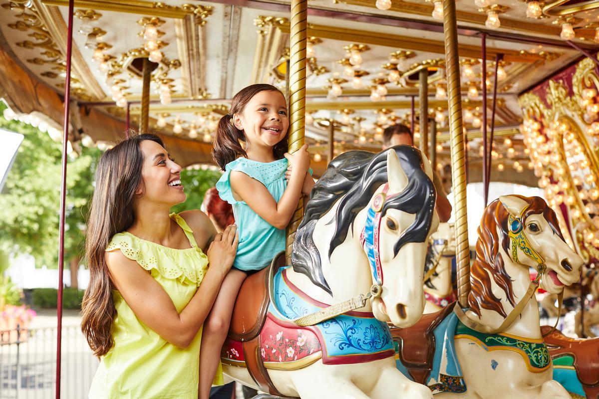 The park's amusement rides include carousels, bumper cars and a ferris wheel / Coney Island Cincinnati