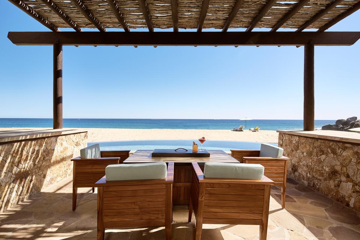 A beachfront suite terrace / Hilton