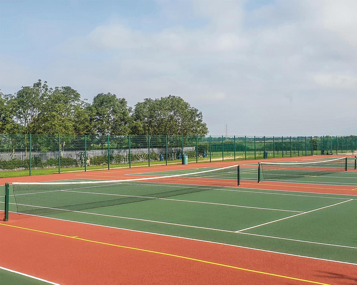 TVS repaired damage to the courts using resin aggregate patching to ensure uniformity