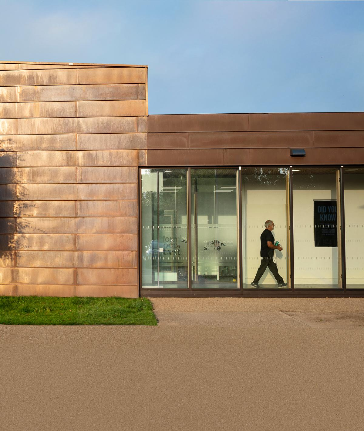 Timber were among the materials used to match the existing building / Tamara Shiner