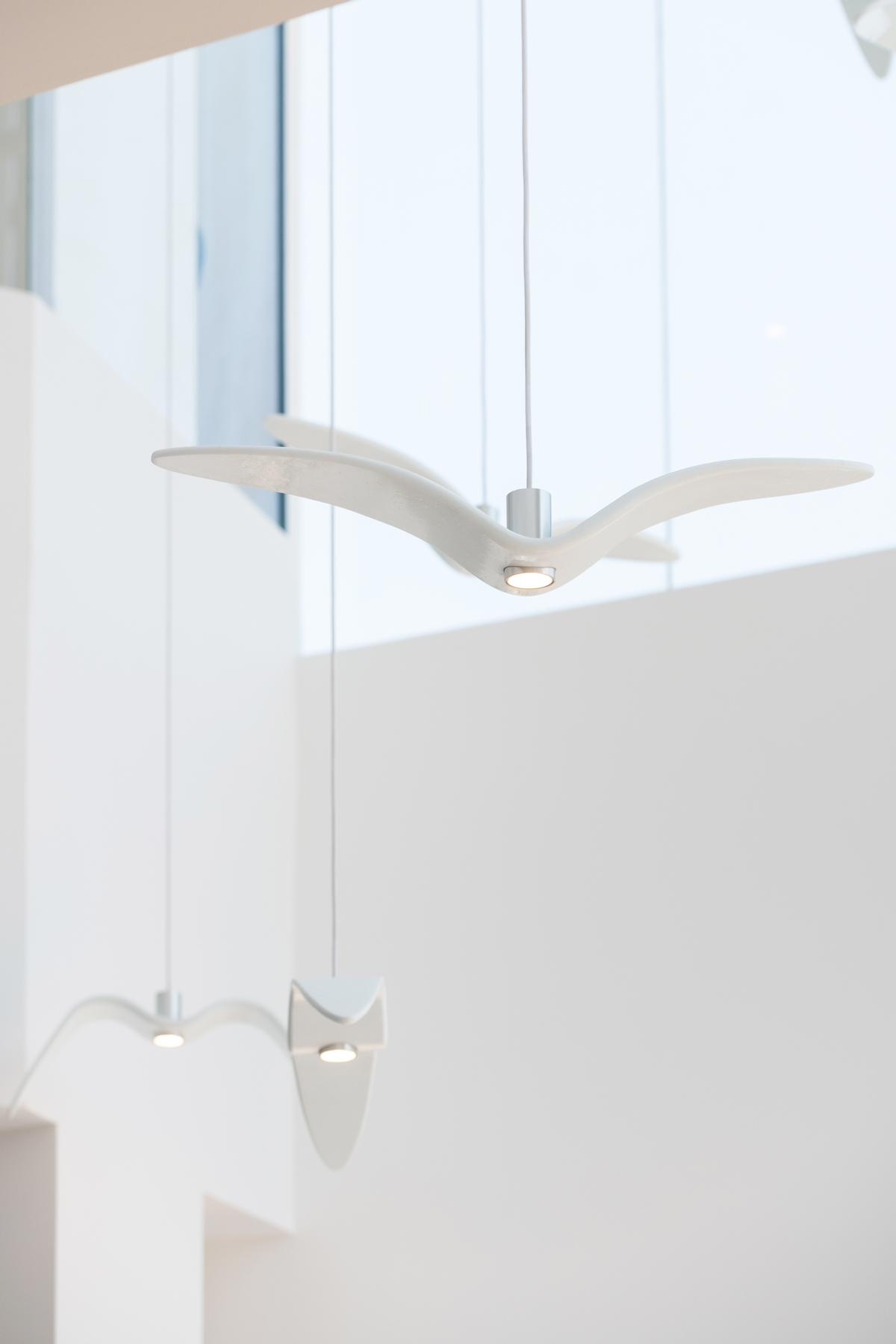 Bird-shaped lights hang from the ceiling / Natelee Cocks