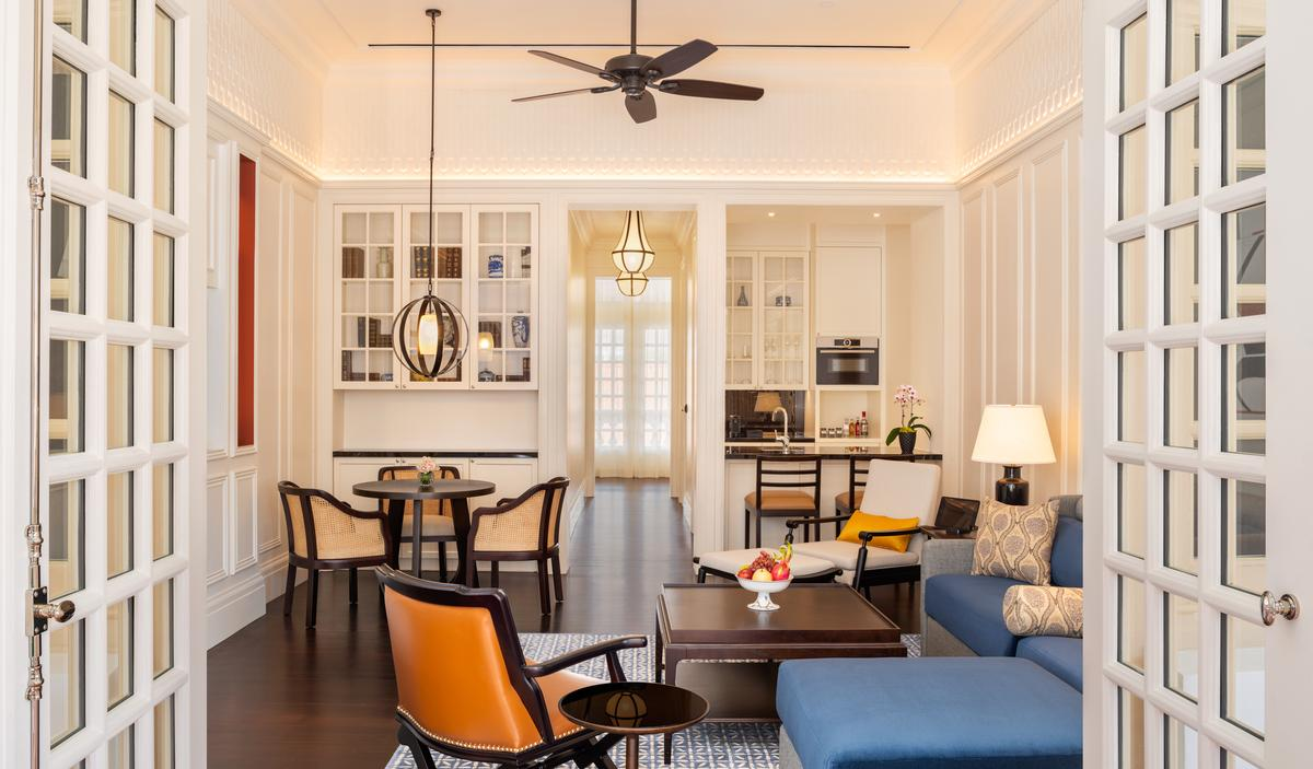 A Residence Suite living room at Raffles Singapore / Accor