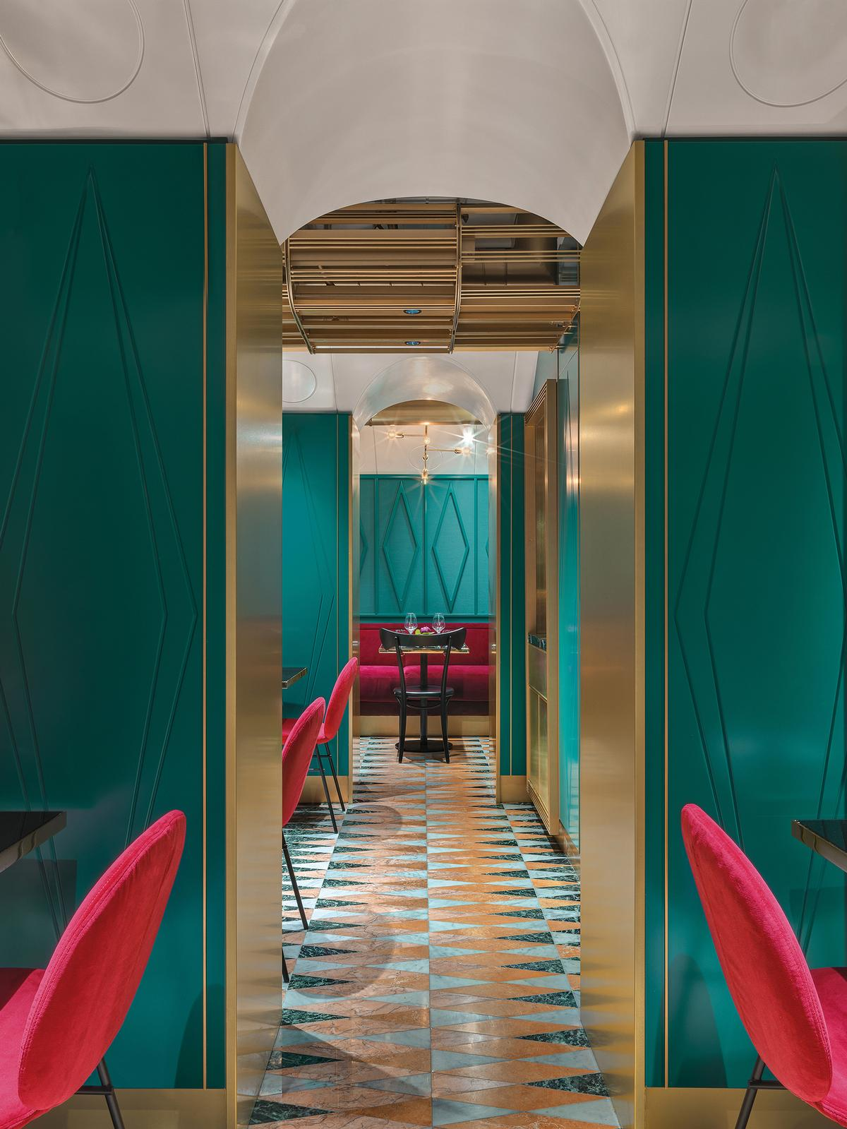 Emerald, gold and burgundy are used for different elements downstairs / Matteo Piazza