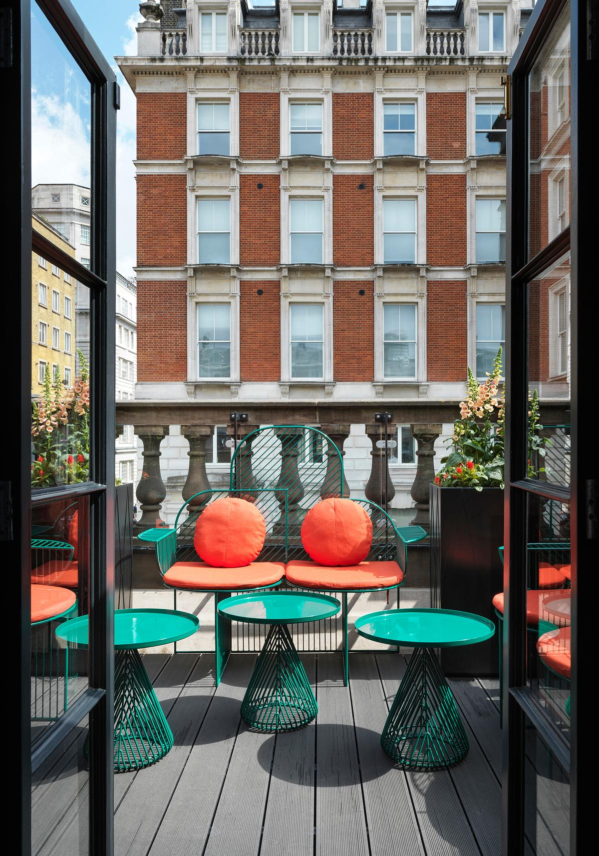 Orange cushions are introduced for outside seating / Matteo Piazza