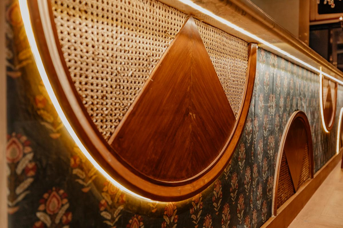 The bar is decorated with a mix of fabrics and wooden elements / Darshan Savla