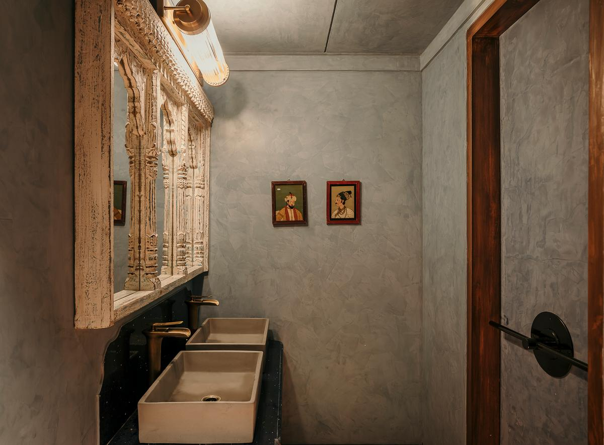 The earthy design theme is drawn through into the toilets / Darshan Savla