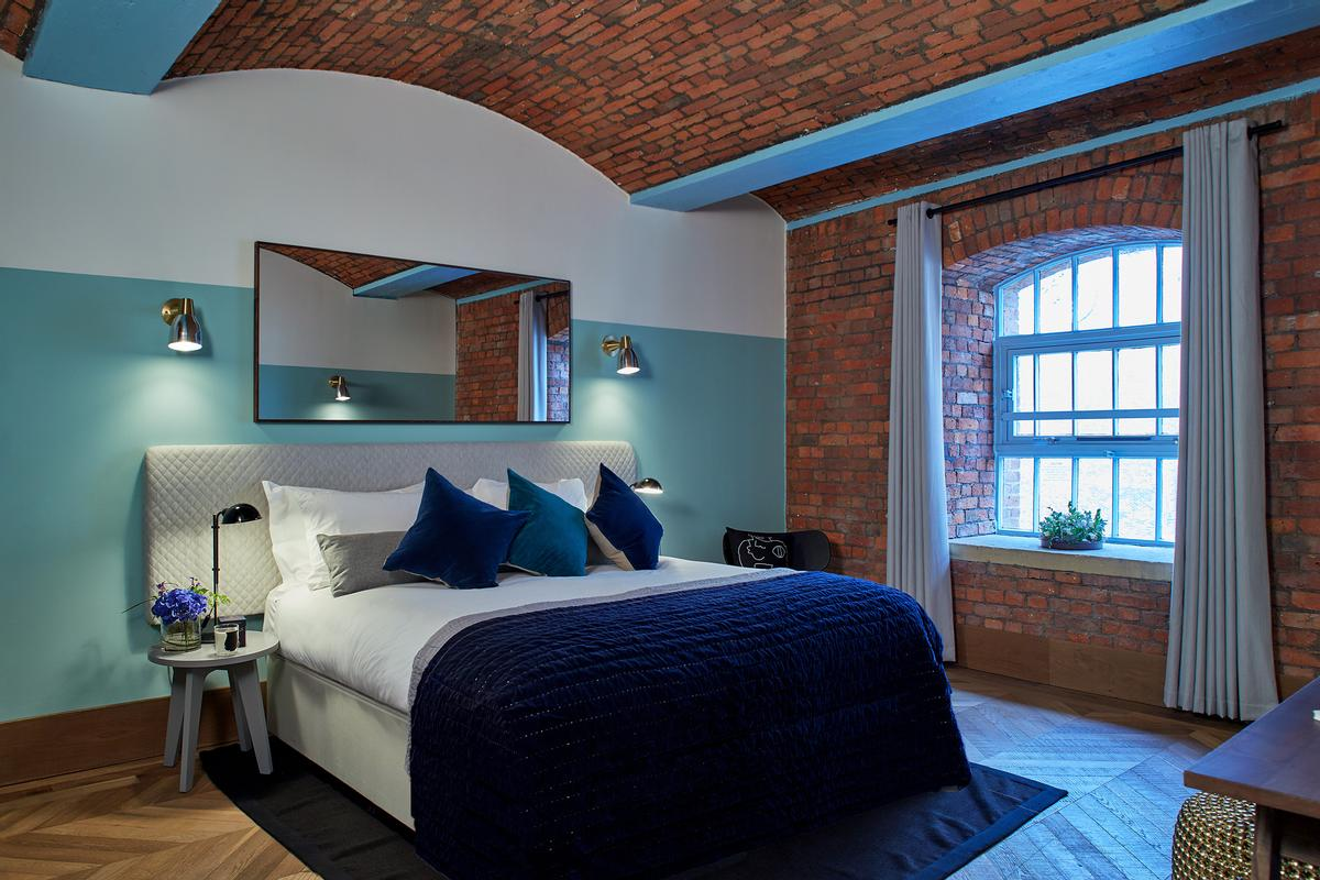 A bedroom in one of the penthouse apartments / Native