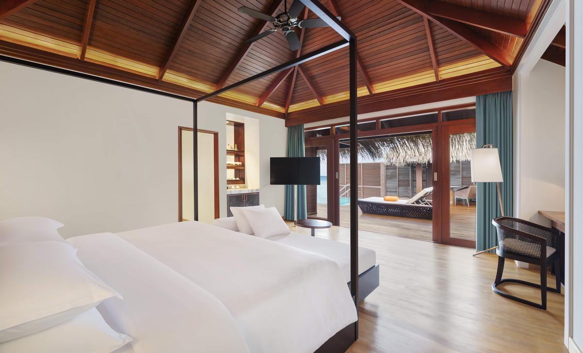 A two-bedroom Water Villa bedroom at the Sheraton Maldives resort