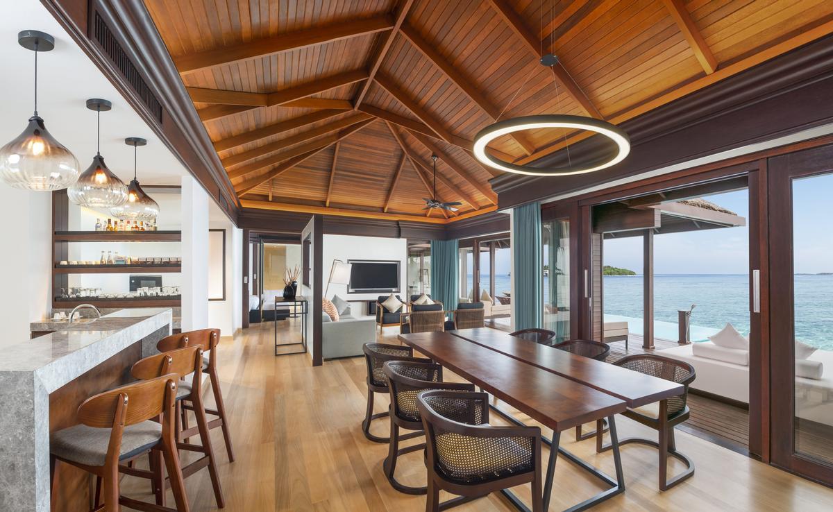 A two-bedroom Water Villa living room at the Sheraton Maldives resort