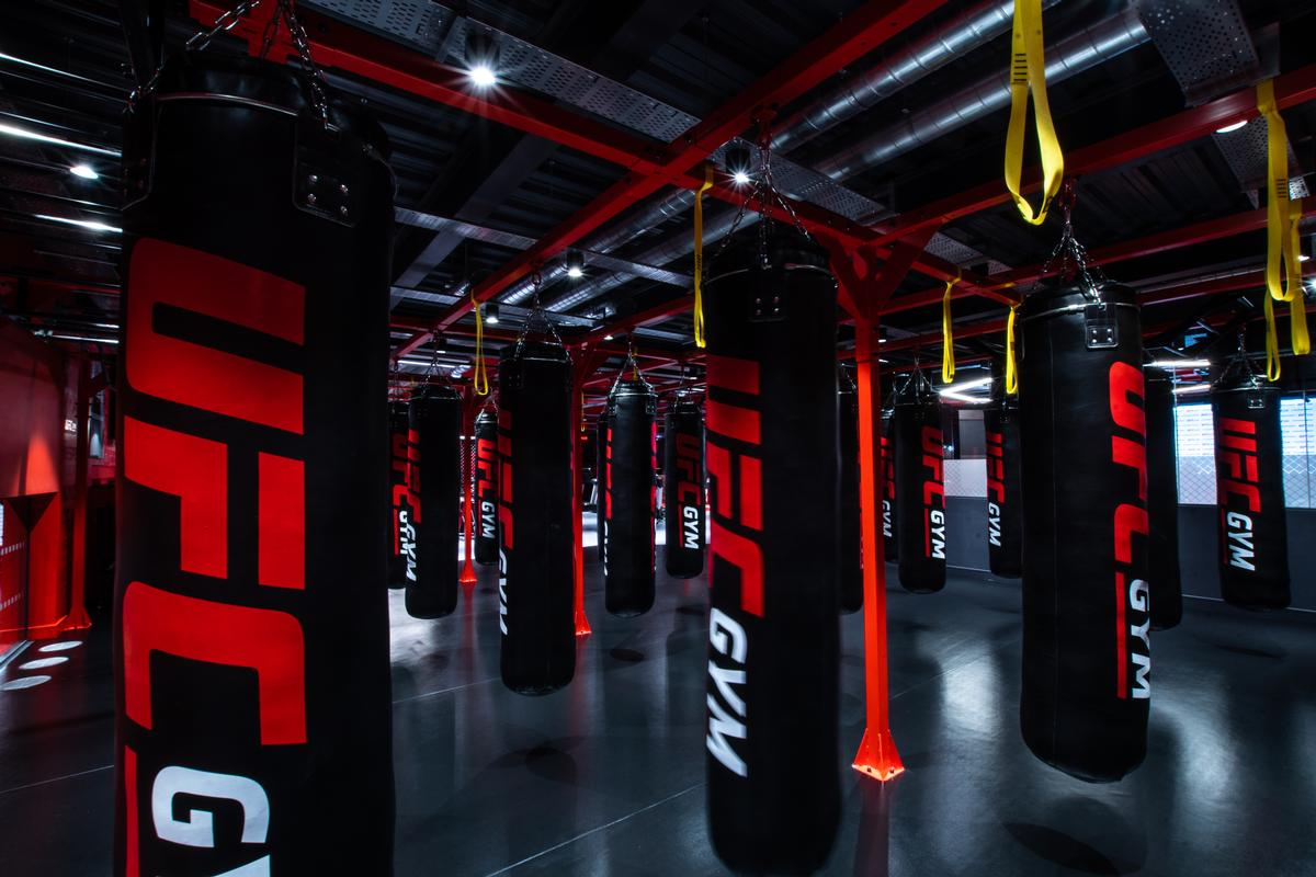 The facility features a bag area with 30 punch bags / UFC Gym