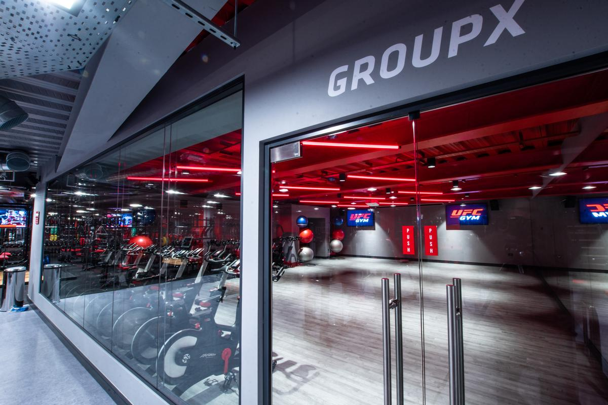 Group exercise areas accommodate large classes / UFC Gym