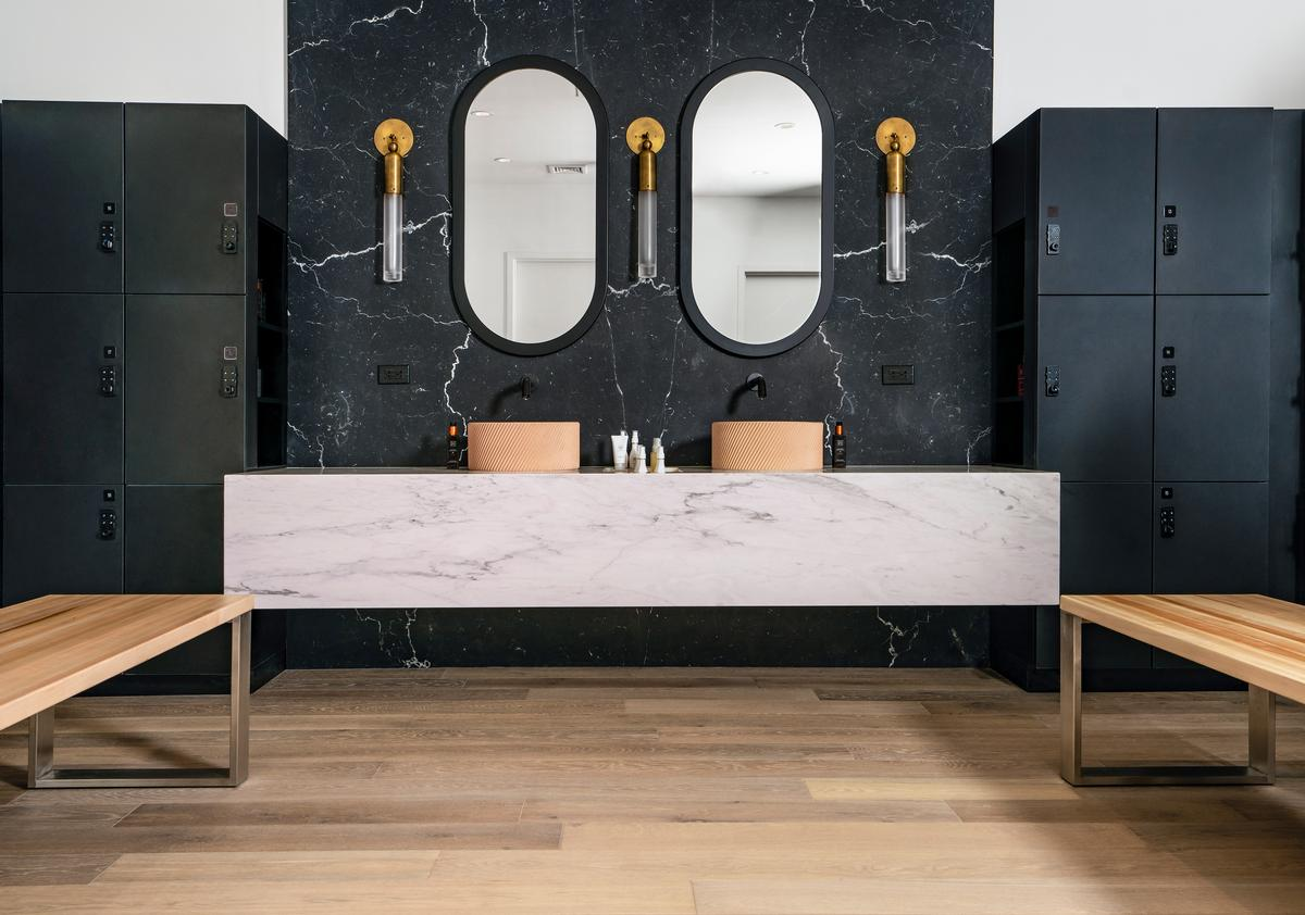 There us a refresh area with a custom marble vanity and backsplash unit / P.volve