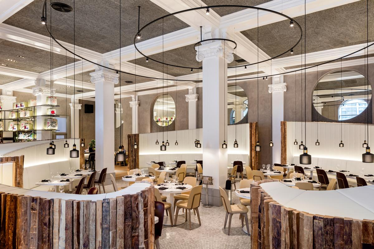 The hotel's Peter Street Kitchen has high ceilings, natural wooden features, marble tables and pendant lighting / Radisson