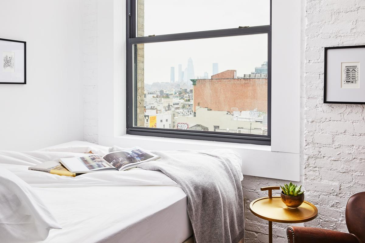 Room details include herringbone wood floors and crisp linens / Read McKendree