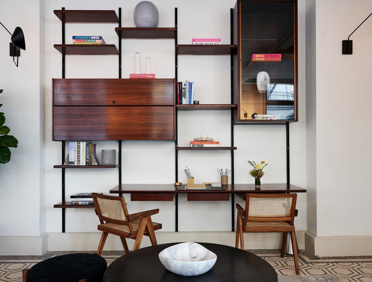 Features include mid-century Osvaldo Borsani rosewood shelving / Adrian Gaut