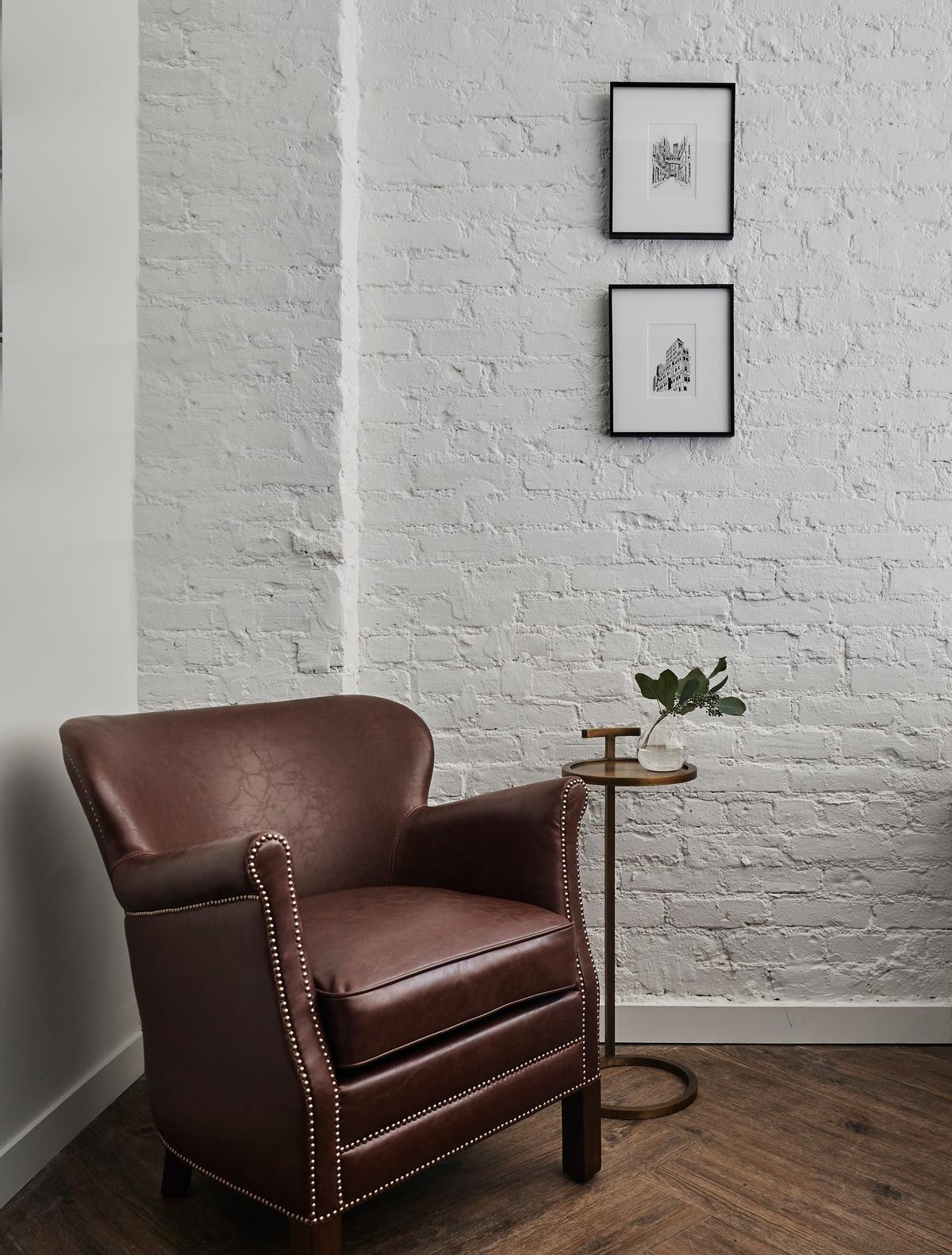 There are tobacco leather professor chairs in each of the rooms / Adrian Gaut