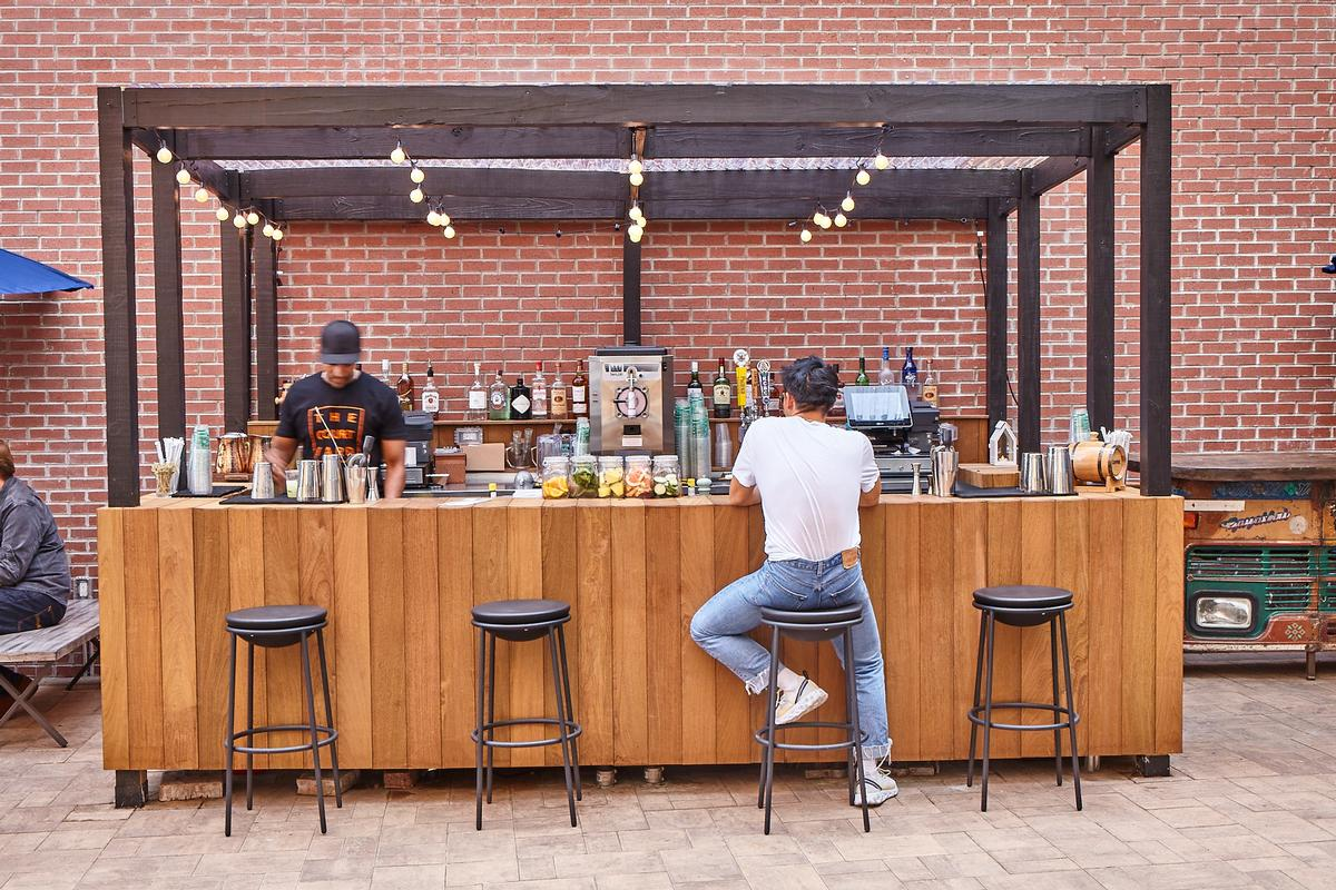 The outdoor space has its own bar / The Collective