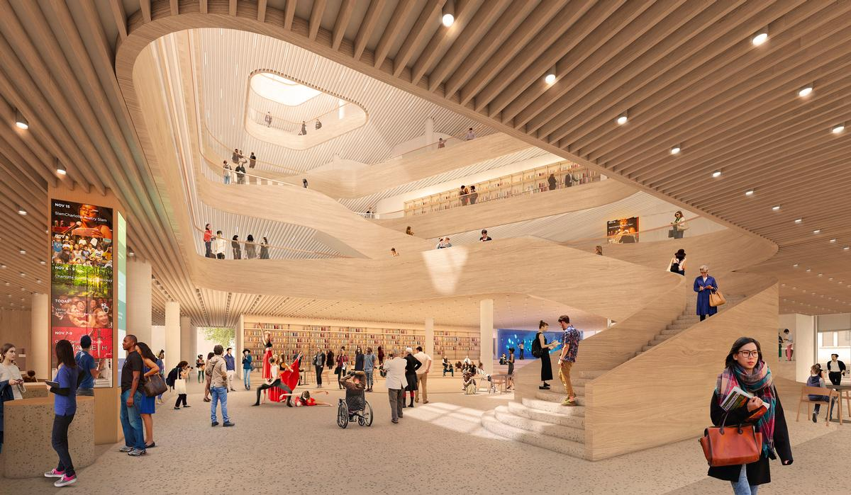 A wooden spiral staircase provides views around the library and out over the city / Snøhetta