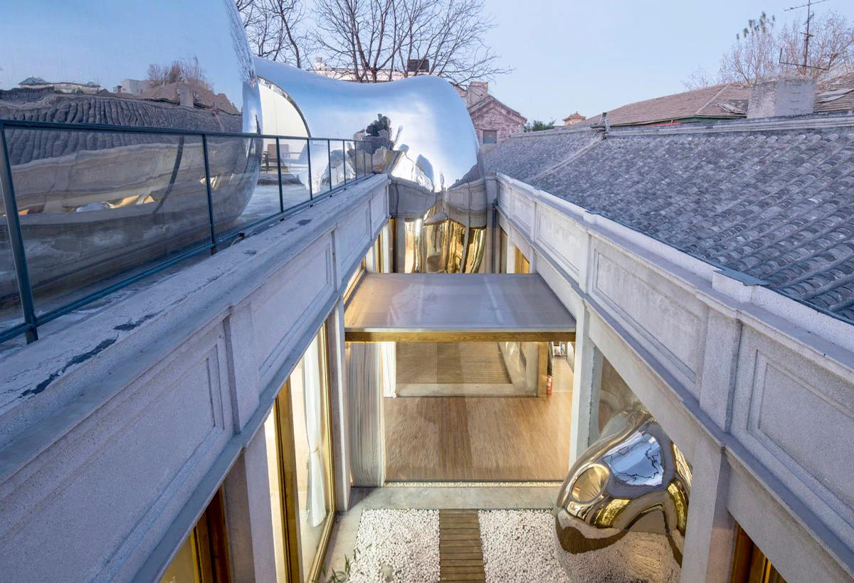 One emerges through a roof connecting two levels / MAD Architects