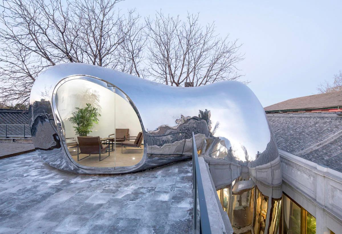 The stainless steel bubbles are designed to fit into specific spaces / MAD Architects