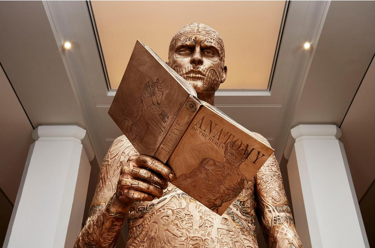 Upon entering the galleries, visitors are confronted by Marc Quinn's bronze sculpture, inspired by deceased full body tattoo model Rick Genest / Science Museum Group / Marc Quinn Studio