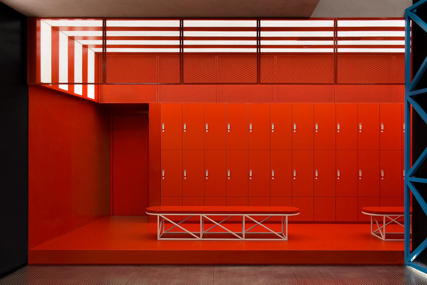 A locker room in the gym is almost entirely red